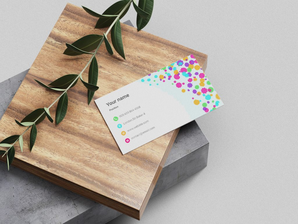 business card with wood block and leaf