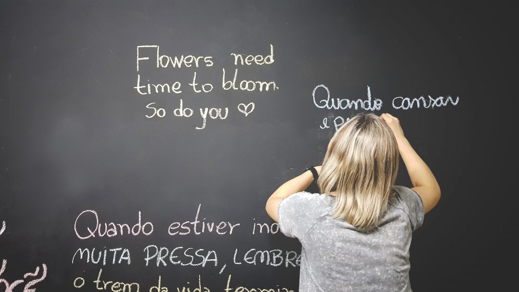girl writing on the board