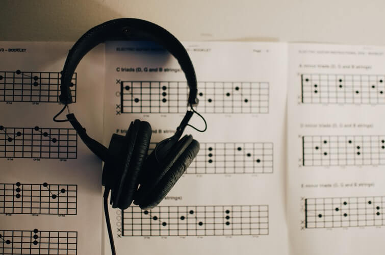 Image with music book and headphone